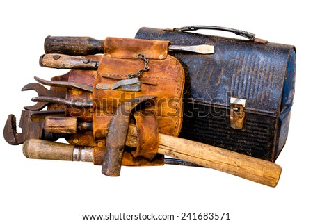Vintage tools, tool belt, and lunch box isolated on white background with clipping path. - stock photo