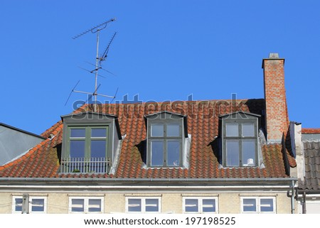 Vintage top of the building with slate roof in Copenhagen, Denmark - stock photo