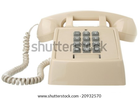 Vintage touch tone telephone isolated on white - stock photo