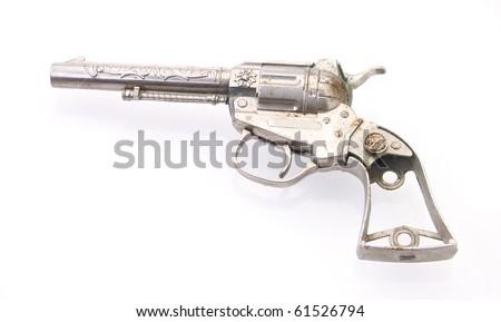 Vintage toy gun on white with reflection - stock photo
