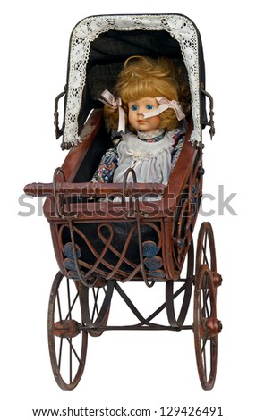 Vintage toy pram with doll isolated. Clipping path included.