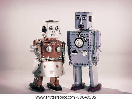 Vintage toy robots male and female - stock photo