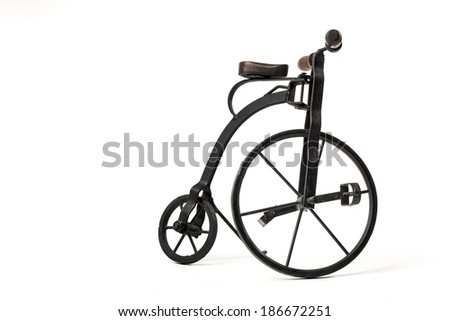 vintage toy velocipede isolated in white - stock photo
