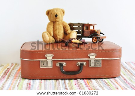 Vintage toys on the old suitcase - stock photo