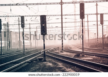 Vintage train station with railway lines in Bohemia. Retro filtered. Monochrome cream tone. Black and white photography. - stock photo