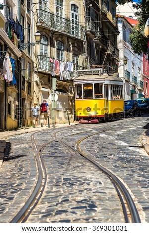 Vintage tram in the city center of Lisbon in a summer day, Portugal - stock photo