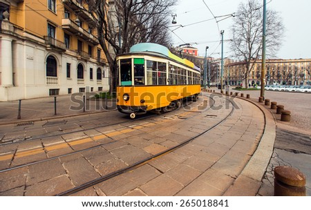 Vintage tram on the city street in Milano - stock photo