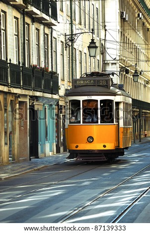 Vintage Trams such as these two are a common site in the Portuguese Capital of Lisbon - Portugal - stock photo