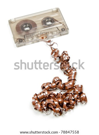 Vintage transparent Compact Cassette with pulled out tape on white background - stock photo