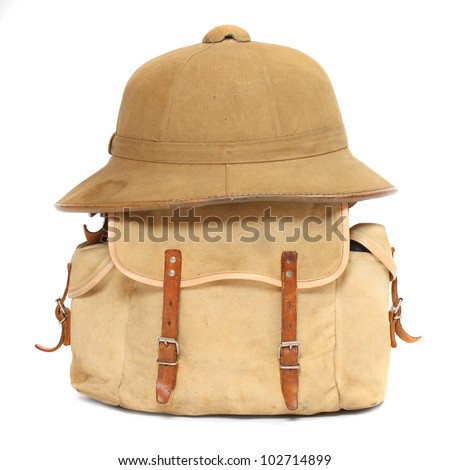 Vintage travel bag and tropical hat. - stock photo
