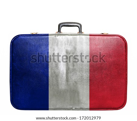 Vintage travel bag with flag of France - stock photo