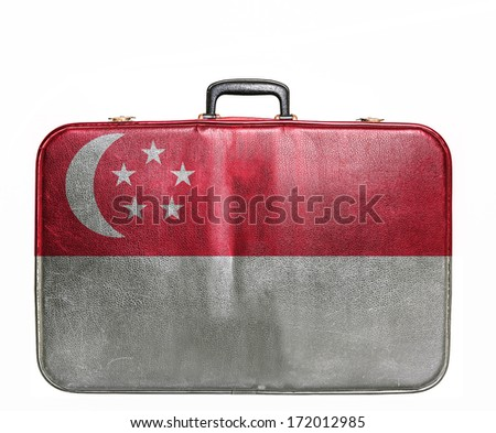 Vintage travel bag with flag of Singapore - stock photo