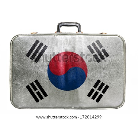 Vintage travel bag with flag of South Korea - stock photo