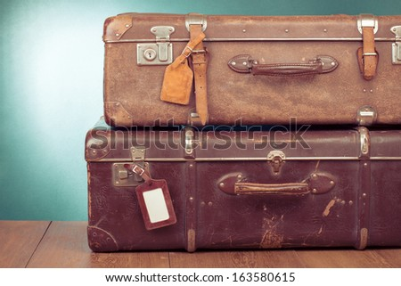 Vintage travel valises with leather name tags blanks - stock photo