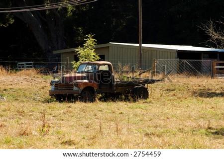 Vintage truck on farmland - stock photo