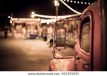 vintage truck under bokeh light from vintage shop and reflect in truck side mirror, vintage style, vintage retro color tone, present in vintage concept