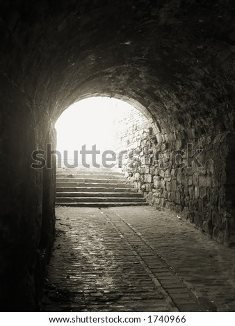 vintage tunnel glowing with morning light - black & white photo - stock photo
