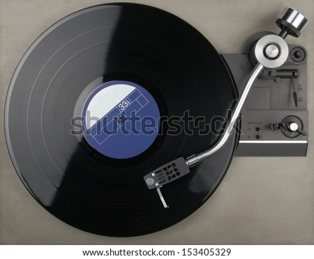 Vintage turntable with phonorecord - stock photo