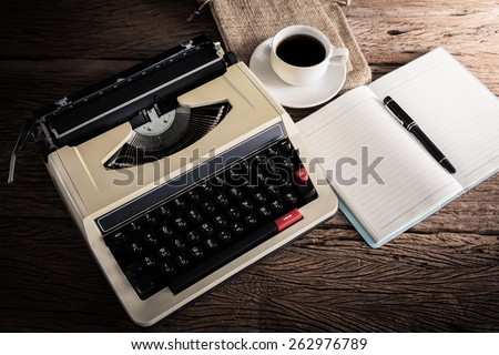 Vintage typewriter and a blank notebook , pen and coffee cup, retro colors - stock photo