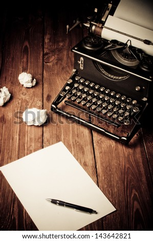 Vintage typewriter and a blank sheet of paper, retouching retro - stock photo