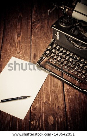 Vintage typewriter and a blank sheet of paper, retouching retro