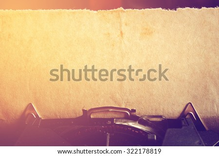 Vintage typewriter and an old paper. - stock photo