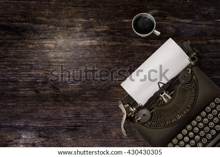 Vintage typewriter and coffee on wood background - stock photo