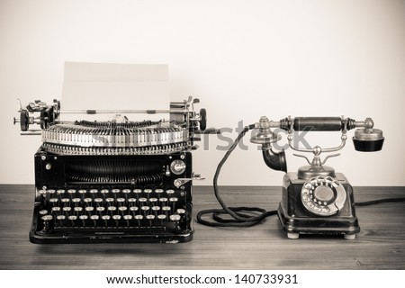 Vintage typewriter and telephone old style sepia photography - stock photo