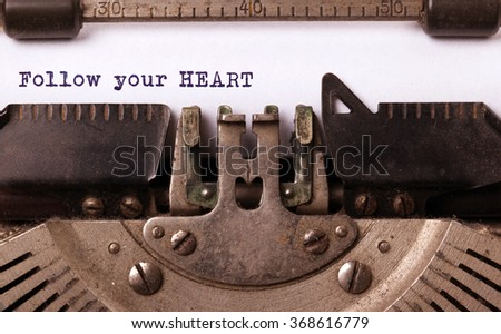 Vintage typewriter close-up - Follow your Heart message - stock photo
