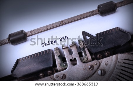 Vintage typewriter close-up - Think BIG, concept of progress - stock photo