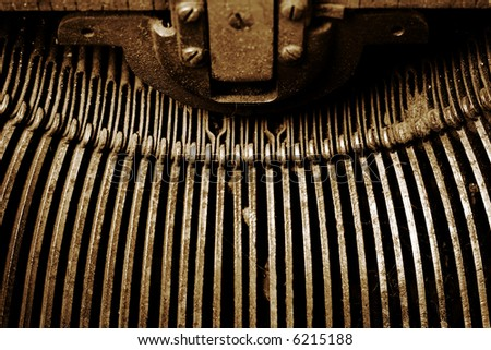 vintage typewriter - letter arms, rusted - stock photo