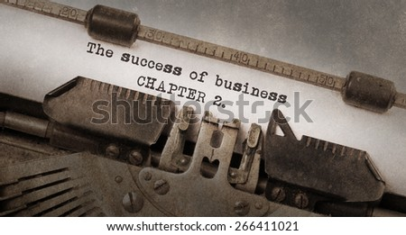 Vintage typewriter, old rusty and used, The success of business, chapter 2 - stock photo