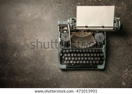 Vintage typewriter on a color background