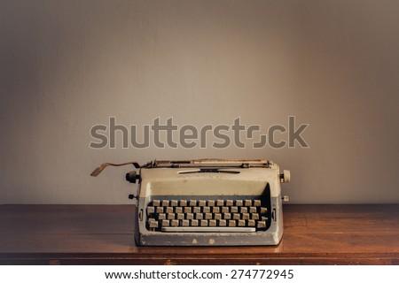 Vintage typewriter on table - stock photo
