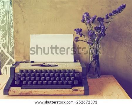Vintage typewriter on the wood desk  - stock photo