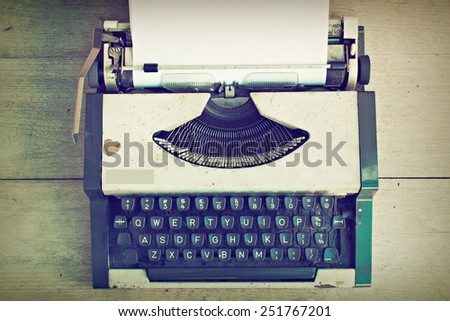 vintage typewriter on the wood desk vintage color - stock photo