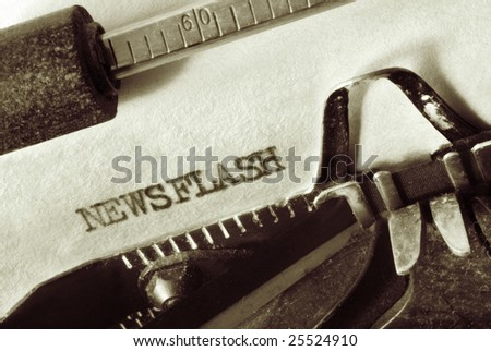 "Vintage typewriter with aged paper, showing the word ""Newsflash"".  Close-up view, with lots of dust and great paper texture, in sepia tone."