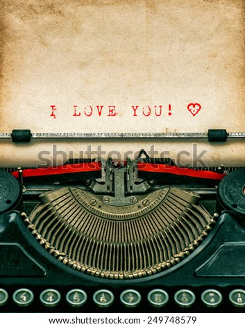 Vintage typewriter with aged textured grungy paper. Sample text I love You! Valentines Day concept - stock photo
