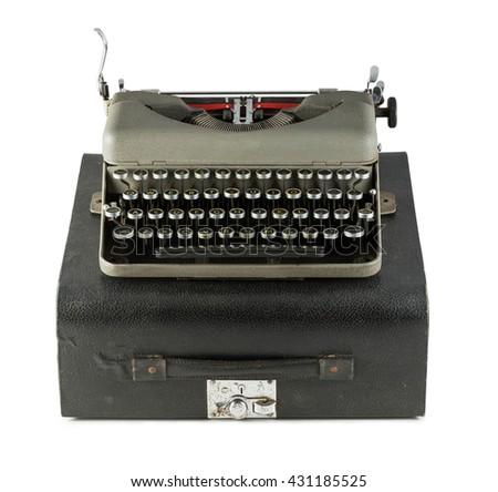 Vintage typewriter with case isolated on white background - stock photo