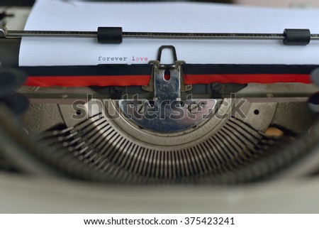 vintage typewriter with forever love text - stock photo