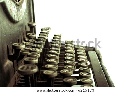 Vintage typewriter with green cast to it -- side view - stock photo