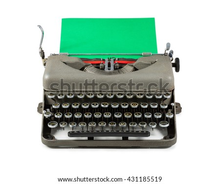 Vintage typewriter with green paper isolated on white background - stock photo