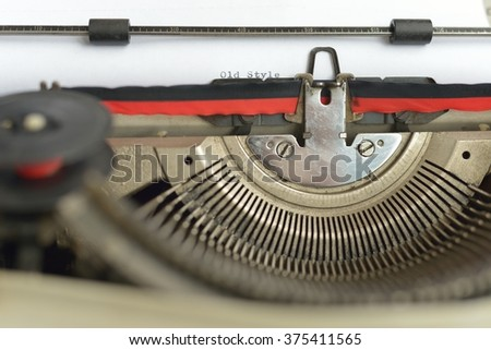 vintage typewriter with old style word text in black ink - stock photo