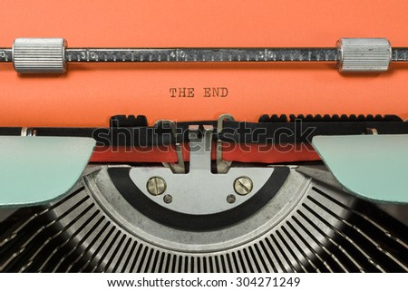 "Vintage Typewriter With Phrase ""THE END"" Typed in Orange Paper - stock photo"