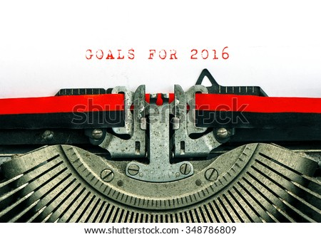 Vintage typewriter with sample text GOALS FOR 2016. Red words on white paper. - stock photo