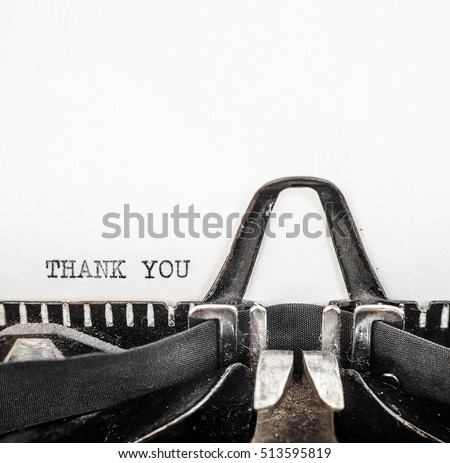 Vintage typewriter with ' THANK YOU ' typed onto white paper with copy space.