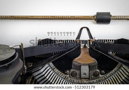 Vintage typewriter with ' ?????????? ' typed onto white paper with copy space.