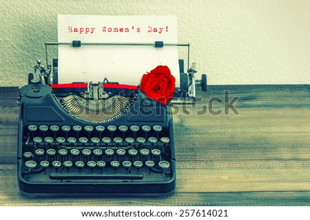 Vintage typewriter with white page and red rose flower. Sample text Happy Women's Day! Retro style toned picture - stock photo