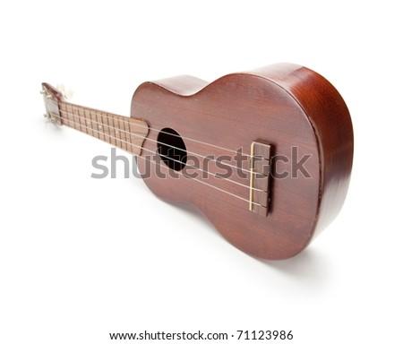 Vintage ukulele isolated on white. - stock photo