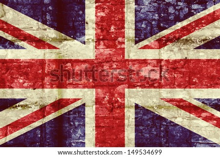 Vintage Union flag on a brick wall background - stock photo